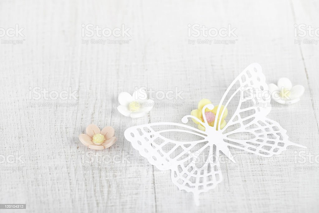 paper butterfly and three sugar blossom flowers royalty-free stock photo