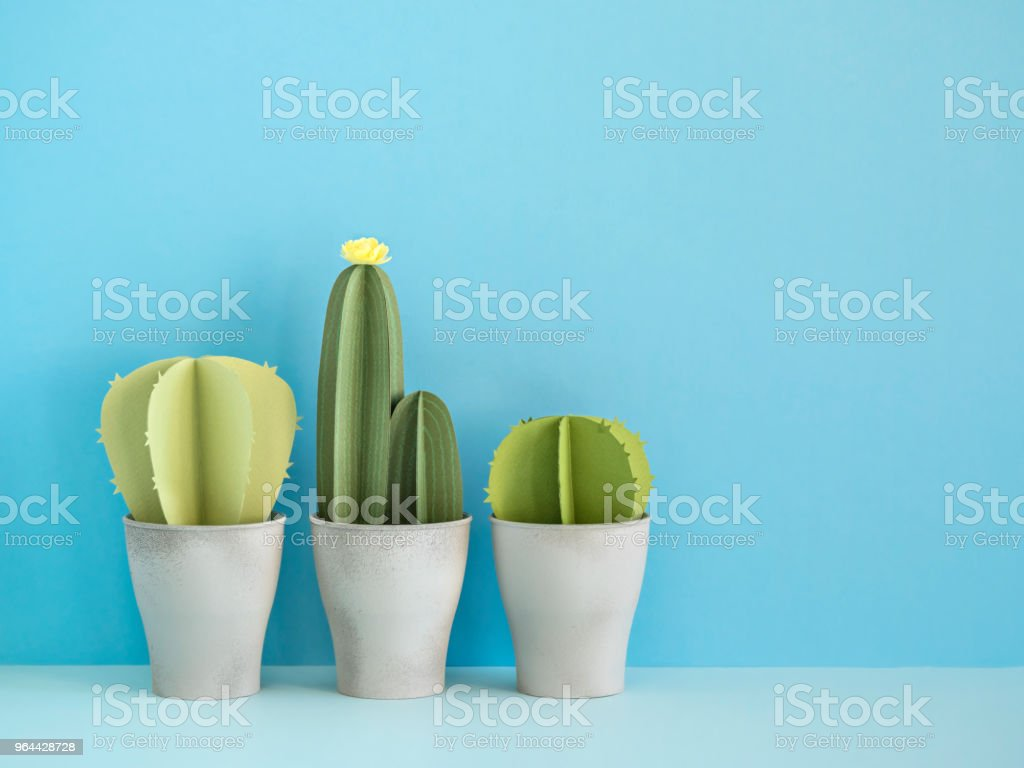 Paper cactuses on blue. - Royalty-free Art Stock Photo