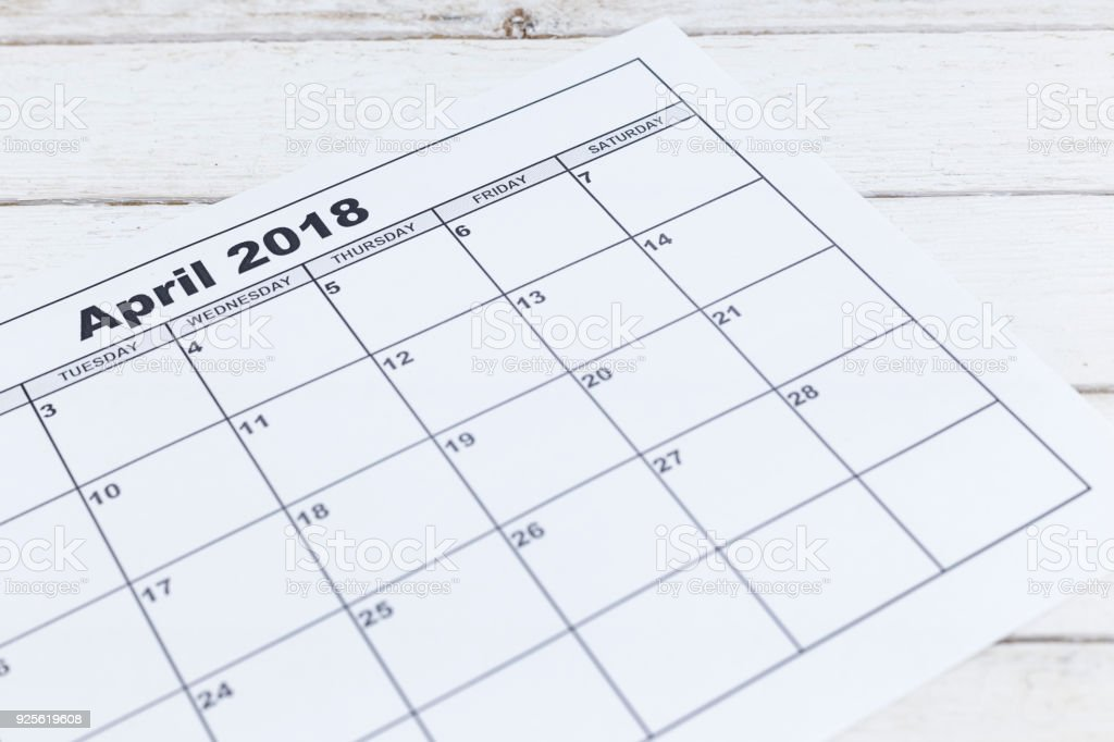 A paper calendar april 2018 on wooden background. stock photo