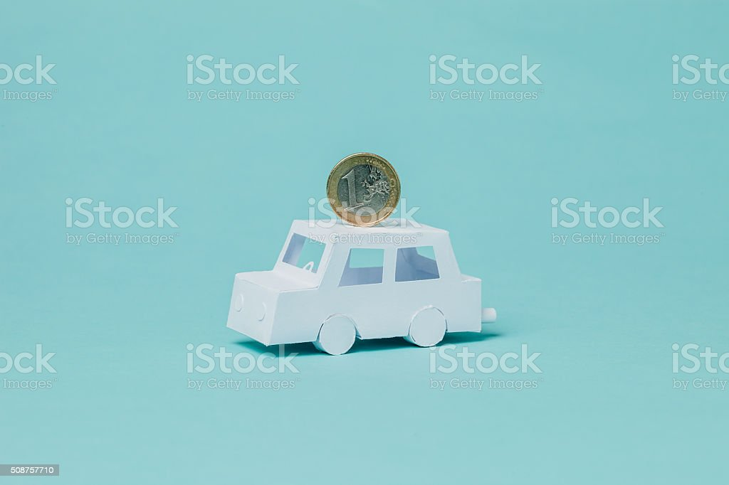Paper car and euro coin stock photo