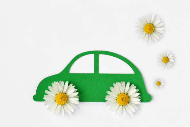paper car cut-out with daisy flowers - ecolology car concept - auto a combustibile alternativo foto e immagini stock