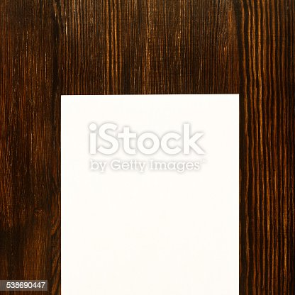 istock Paper card on wooden office desk background 538690447