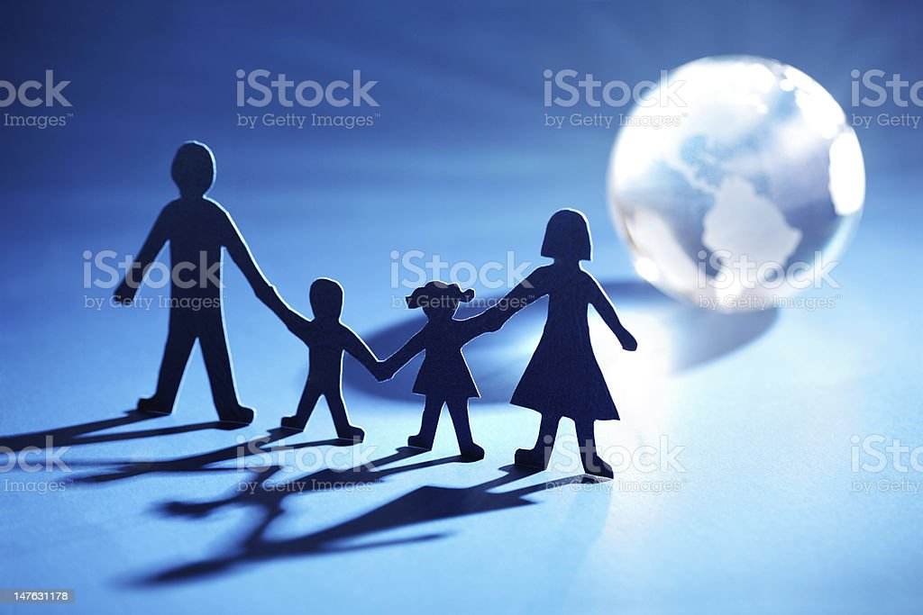 Paper chain family moving towards the light royalty-free stock photo