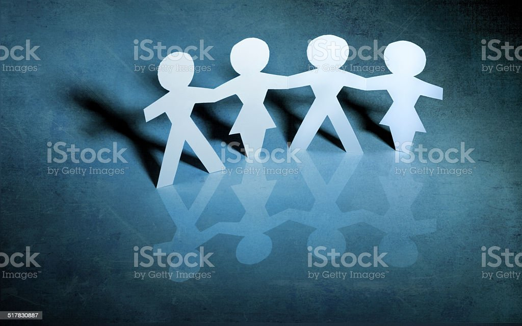 Paper chain girls and boys stock photo