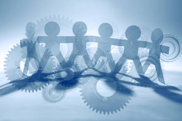 Paper chain team and cogs stock photo