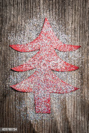 636659848 istock photo Paper Christmas tree over rustic wooden background 625785734