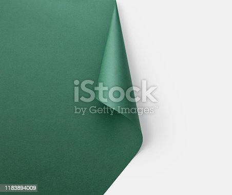 Green paper cone Christmas tree on white background.
