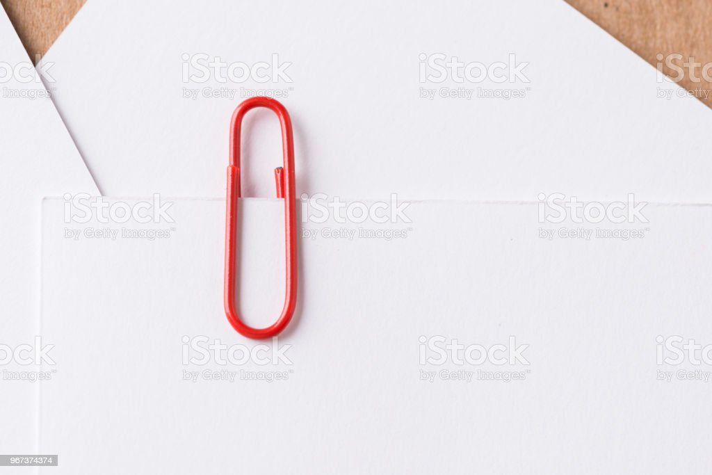 Paper clip with blank white business card stock photo