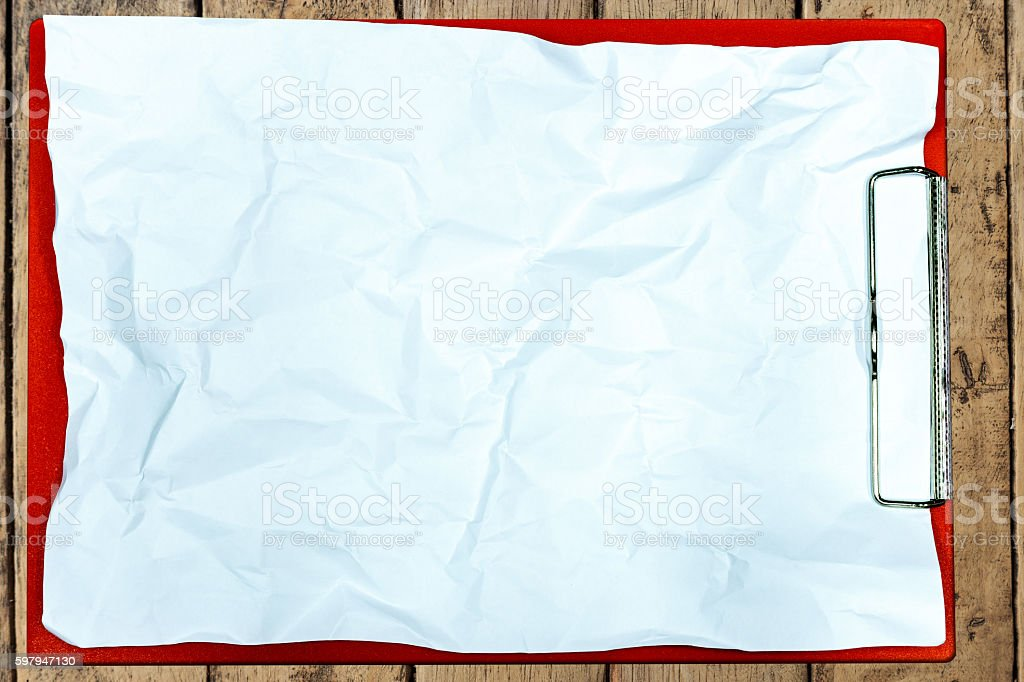 Paper clipboard on wood table foto royalty-free