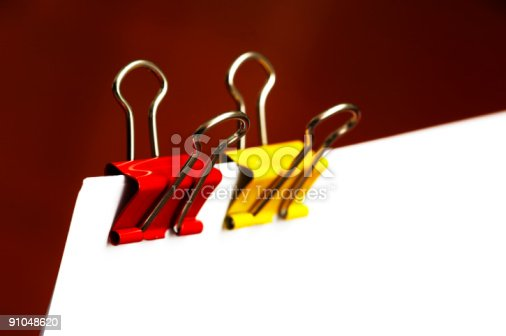 istock paper clips in red and yellow 91048620