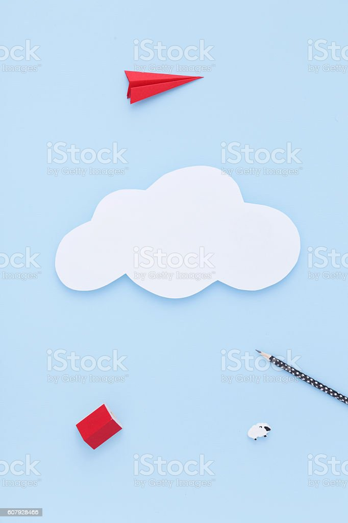Paper cloud on the blue sky. Travellling concept. Flat lay. stock photo