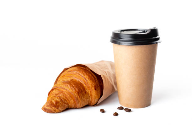Paper coffee cup with croissant Paper coffee cup with croissant isolated on white background. Studio light. Food and drink photo. Good morning concept. croissant stock pictures, royalty-free photos & images