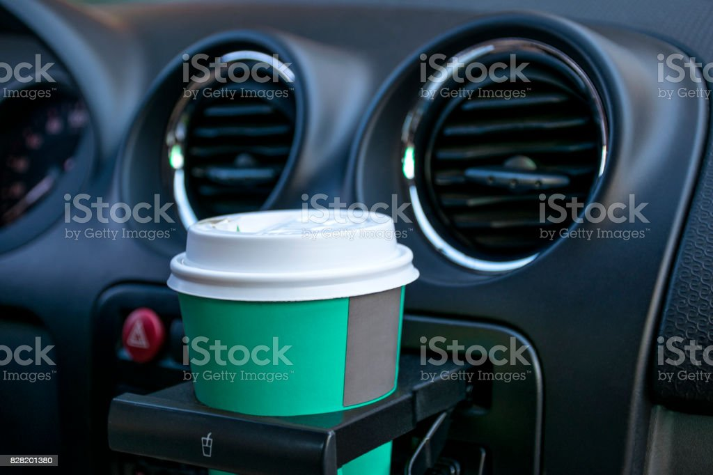 Paper coffee cups inside car cup holder stock photo