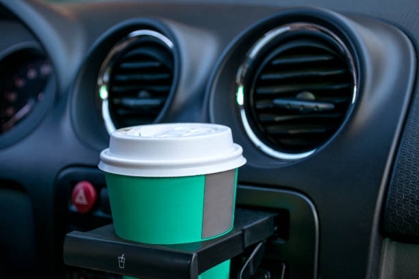 paper coffee cups inside car cup holder - container stock photos and pictures