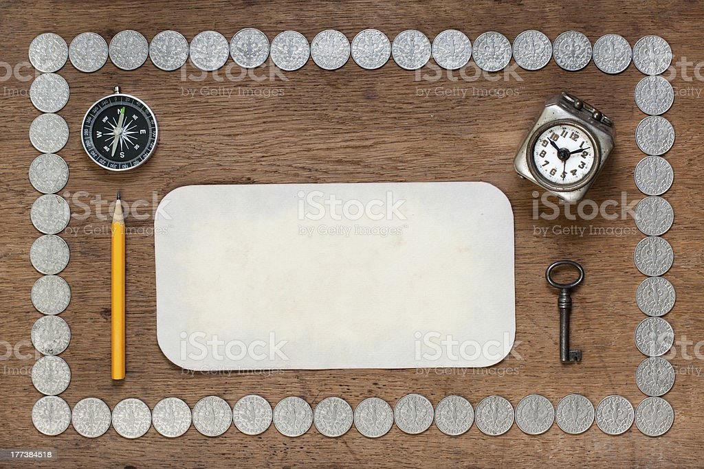 Paper, compass, clock, pencil, key on wood with silver coins royalty-free stock photo