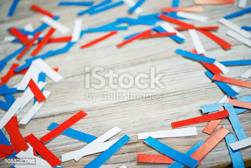 970809318 istock photo Paper confetti of national colors of France, Russia, USA, Serbia white-blue-red on a white wooden background, the concept of independence day and national holidays 1053280098
