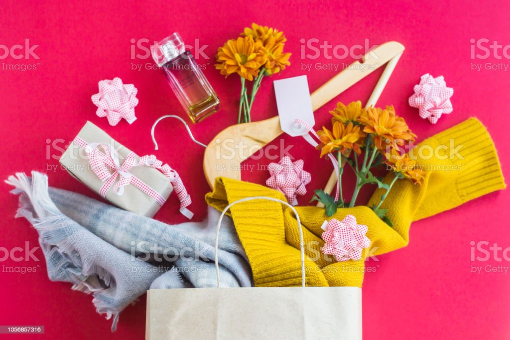 Paper craft package with women\'s purchases - clothes, gifts,...