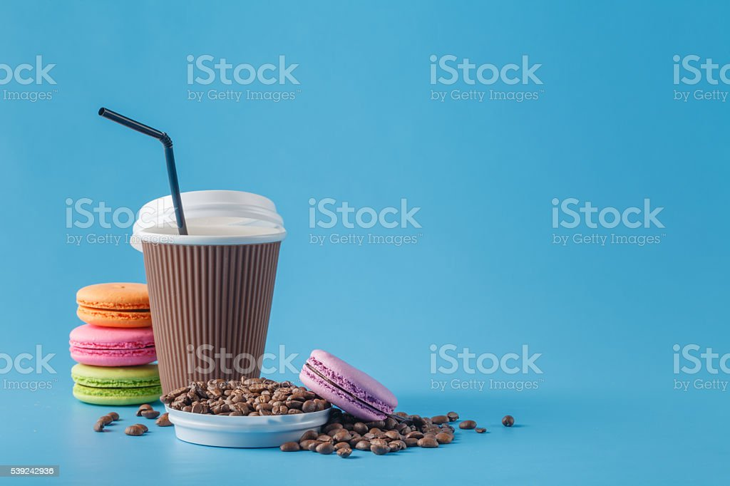 Paper cup of coffee and coffee beans royalty-free stock photo