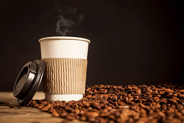 Paper Cup Of Coffee On Black Background Stock Photo