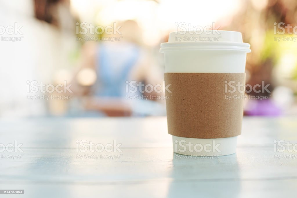 Paper cup of takeaway coffee stock photo