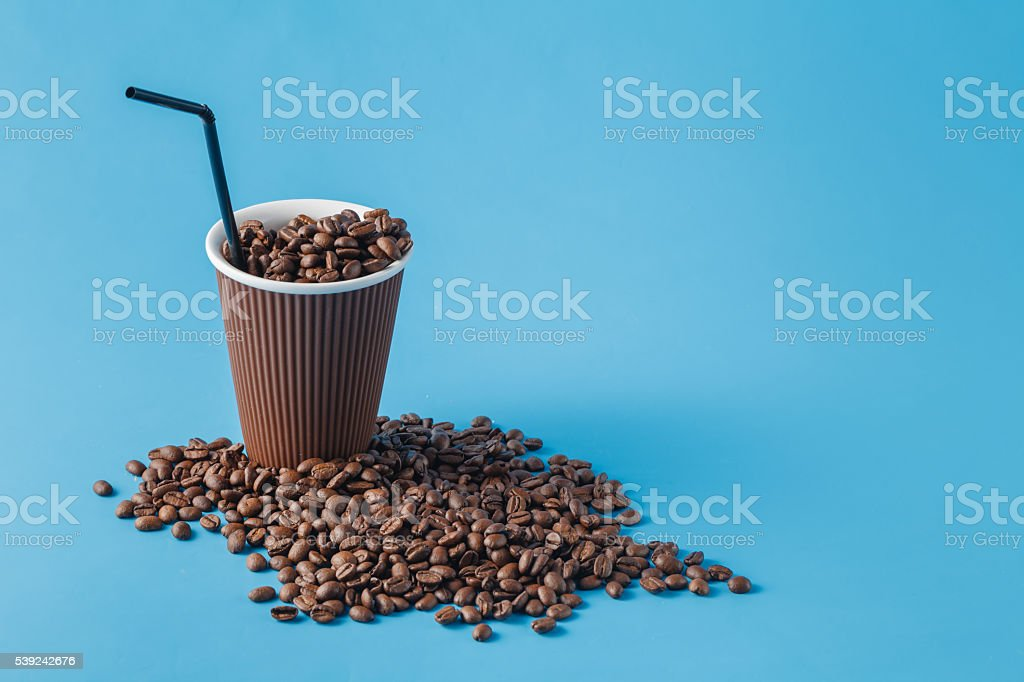 Paper cup on blue background royalty-free stock photo