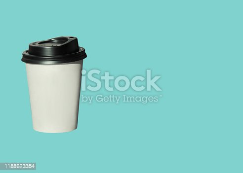 istock Paper cup with hot coffee to go isolated on a light blue background. Take away drinks, fast food. Copy space, price tag. 1188623354
