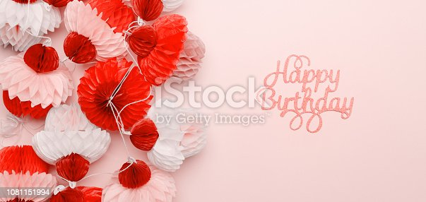 istock Paper cupcakes garland and happy birthday lettering on pink background. Party and celebration concept. Fits great for your any project! . Living coral theme - color of the year 2019 1081151994