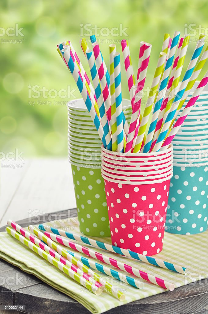 Paper cups and striped straws stock photo