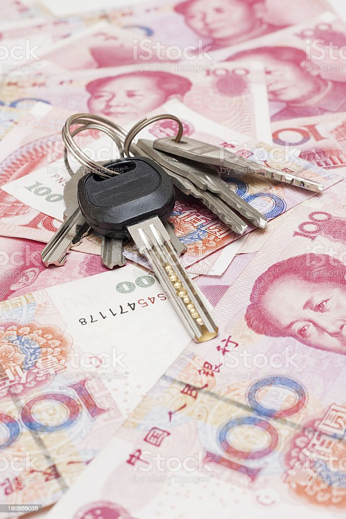 Paper currency and keys royalty-free stock photo
