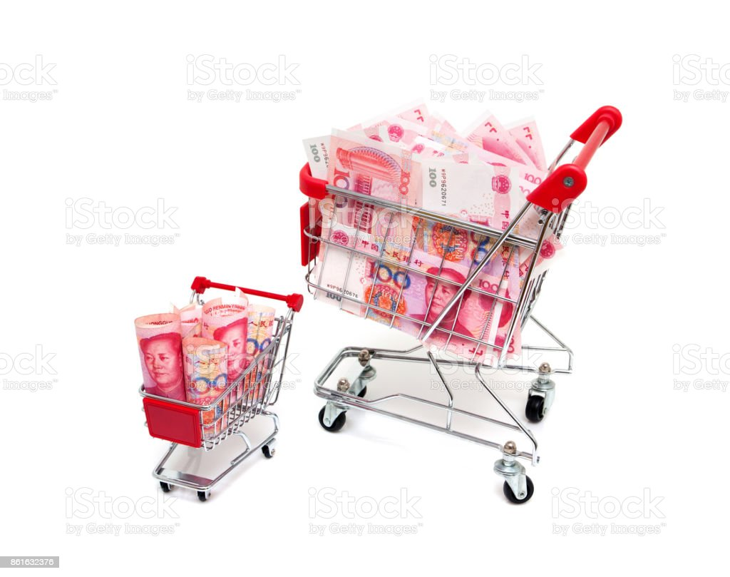 Paper Currency in shopping cart isolated on white background stock photo