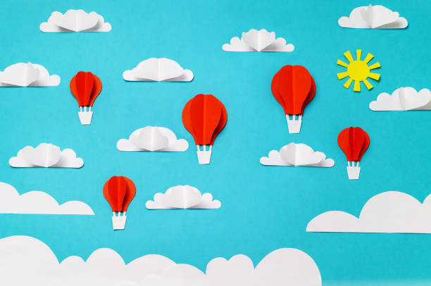 Paper cut and origami hot air balloons, clouds, and sun. Creative concept for banner/landing/background designs. stock photo