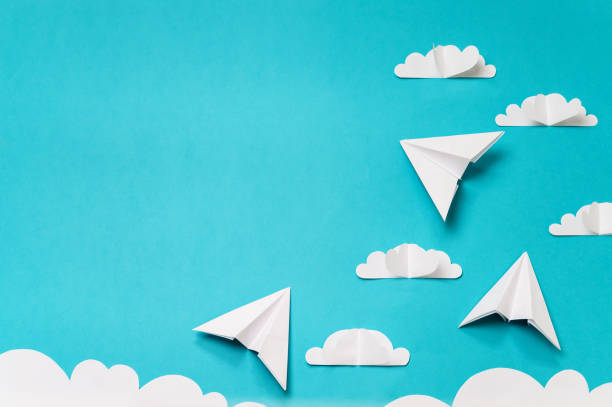 Paper cut clouds and origami planes. Creative concept for banner/landing/background designs. stock photo