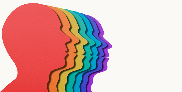 Paper Cut Layered Rainbow Colored Head Shapes. Team rainbow people in profile. Layered paper cut. Unity and recognition of orientation. For create letter or symbol, business, banner, advertising concept, banner size with copy space