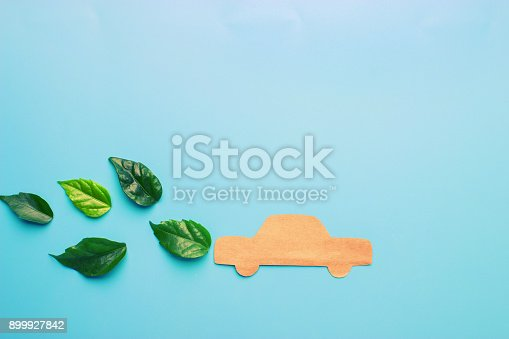 istock Paper cut of car on blue background 899927842