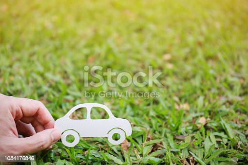 istock Paper cut of car on green grass background, earth day concept with copy space, spring time, background and banner 1054176846
