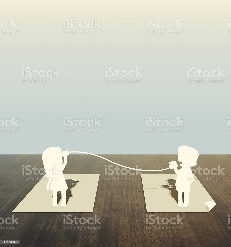 Paper cut of child talk on wood table royalty-free stock photo