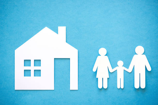 paper cut of family on blue background - stick figure stock photos and pictures