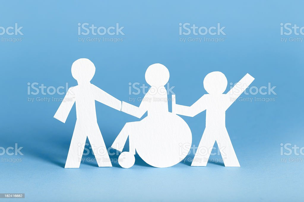 paper cutouts of people helping the handicapped stock photo more