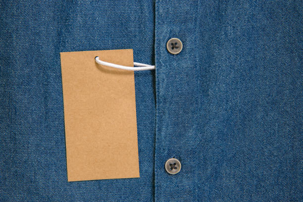 paper denim tag with buttons stock photo
