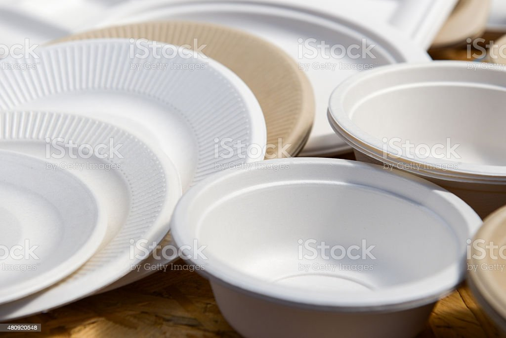 paper disposable plates of different colors stock photo