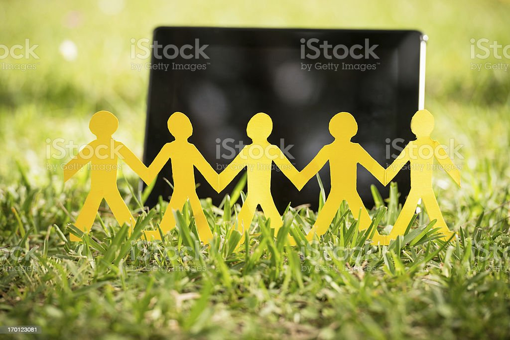paper doll family with tablet on the grass royalty-free stock photo
