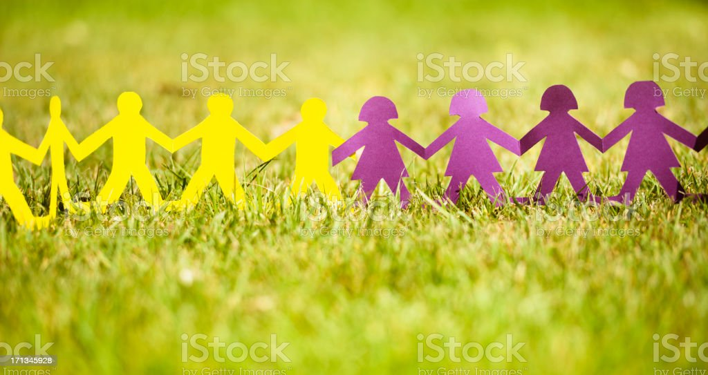 Paper doll on the grass like a community -  Teamwork royalty-free stock photo
