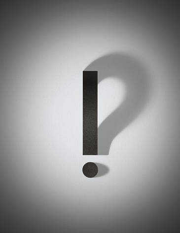 istock Paper exclamation mark with question mark shadow 1048039800