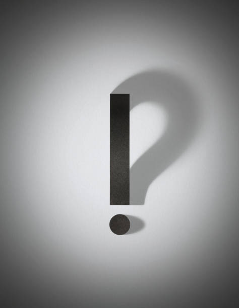 Paper exclamation mark with question mark shadow stock photo