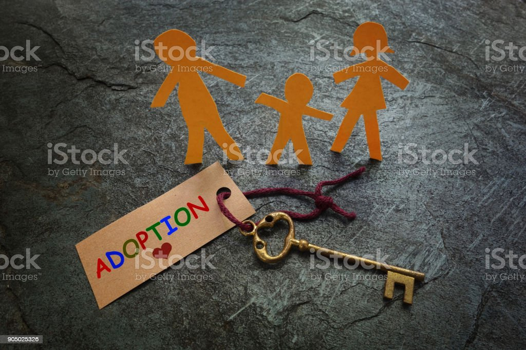 Paper family gold Adoption key stock photo