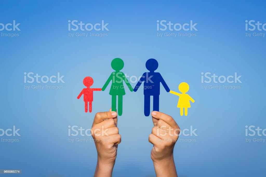 Paper family in hands royalty-free stock photo