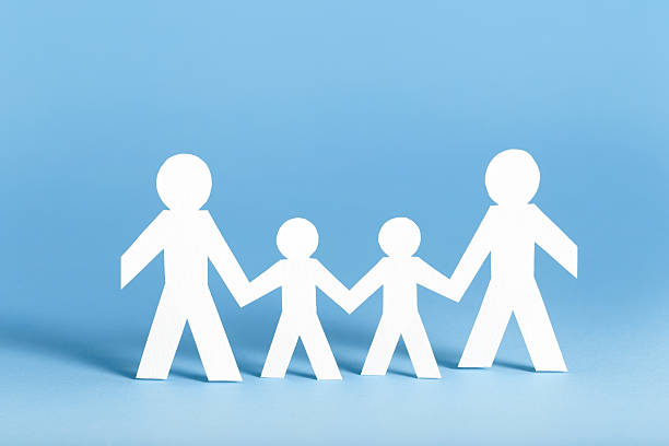 A paper family on a blue background stock photo