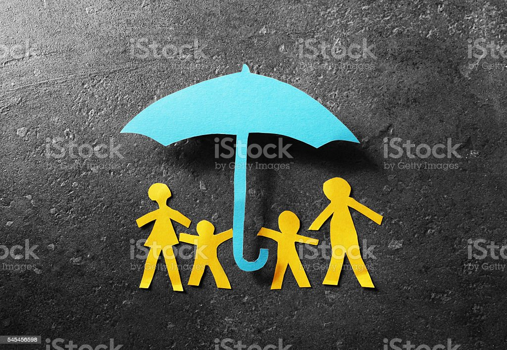 Paper family under umbrella stock photo