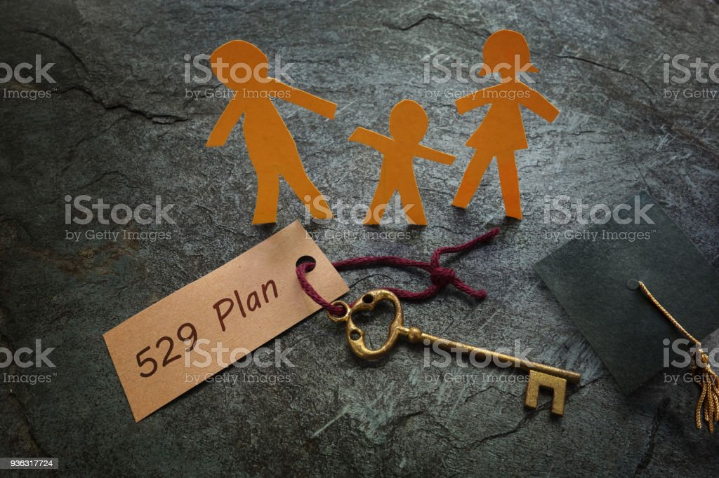 Paper family with 529 Plan gold key stock photo