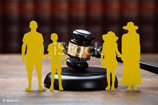 istock Paper Family With Mallet On Table In Courtroom 618530452